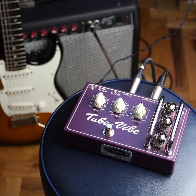 Tube-Vibe Guitar pedal on a stool with guitar and amp in background
