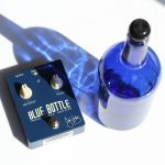 Guitar pedal and a blue glass bottle