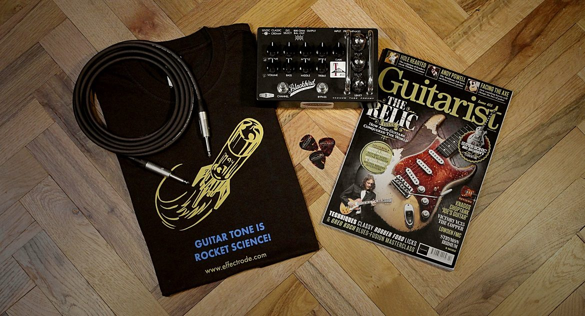 a photo of prizes including a T-shirt, magazine, guitar pedal and cable
